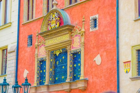 impressive: Prague, Czech Republic - 13 August, 2015: Beautifully decorated red facade with golden arches and details, Old town Square. Editorial