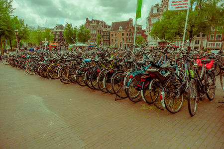 proving: Amsterdam, Netherlands - July 10, 2015: Huge bicycle parking in city centre, proving that the Dutch certainly are a nation of bikers.
