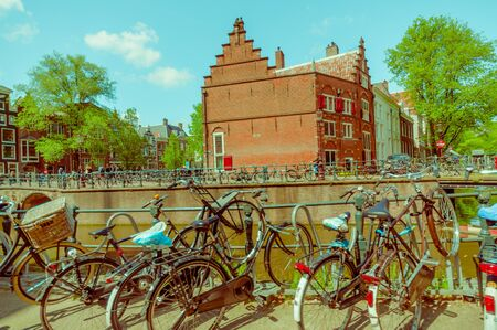 nice accommodations: Amsterdam, Netherlands - July 10, 2015: Bicycle parking alongside one of the many water channels running through city. Editorial