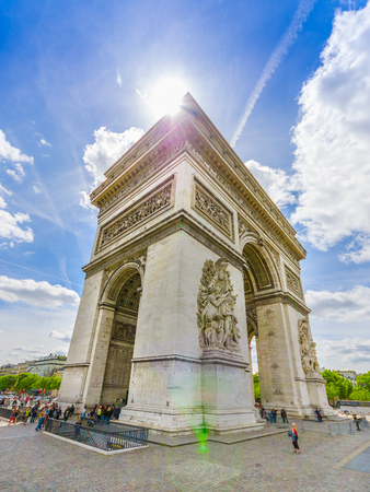 the close range: Paris, France - June 1, 2015: Spectacular view magnificent monument Arch of triumph, as seen from close range on a beautiful sunny day.