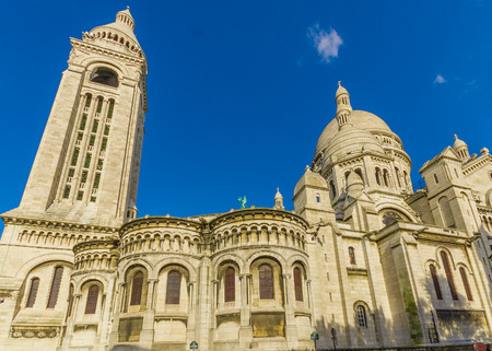 Paris, France June 1, 2015: Spectacular Basilica of the Sacred Heart located in Montmarte part of town, as seen from outside on a beautiful sunny day.