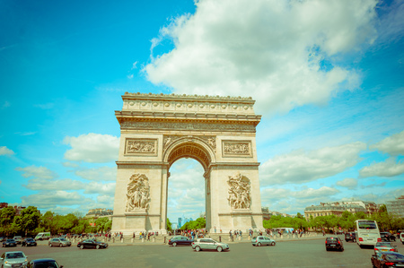 triumphe: Paris, France - June 1, 2015: Spectacular view magnificent monument Arch of triumph, as seen from close range on a beautiful sunny day.