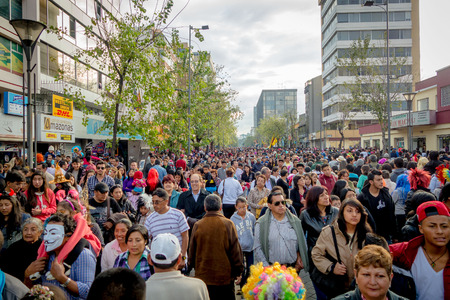 Quito, Ecuador - January 26, 2015: Large crowd celebrating new years Quito, Ecuador during daytime gathering in city streets. Editorial