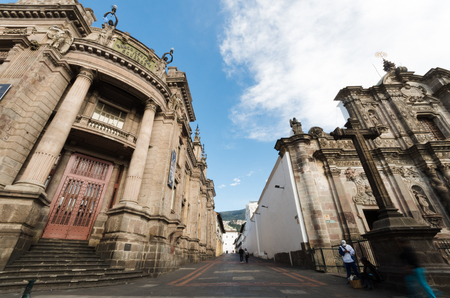 pilasters: Central bank of Equator country, big main door and  gripping old architecture, large street on the side with church,