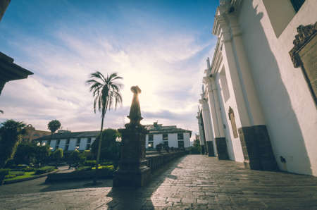 municipality: Beautifull view from the center of the place to the municipality in Quito, palm and blue sky in sepia filter Stock Photo