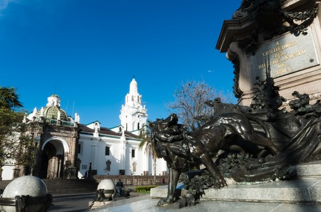 down town: Independence monument in the central square of Quito down town in nice day, imposing lion and church behind