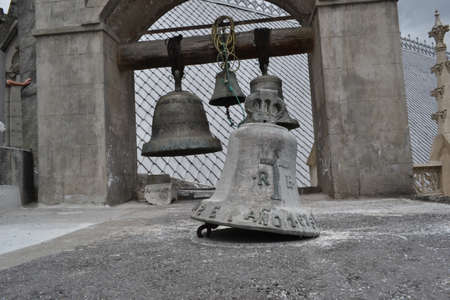 wooden stick: Old traditional used church bells hanging together on wooden stick. Stock Photo