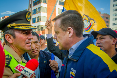 misuse: Quito, Ecuador - April 7, 2016: Closeup opposition leader Andres Paez sorrounded by people, police and journalists during anti government protests in Shyris Avenue. Editorial
