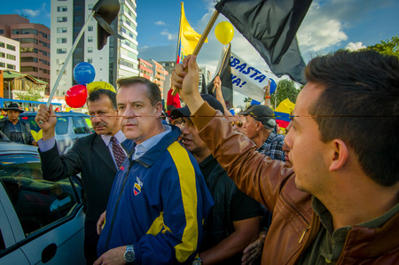 misuse: Quito, Ecuador - April 7, 2016: Closeup opposition leader Andres Paez sorrounded by people during anti government protests in Shyris Avenue.