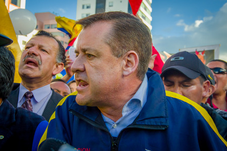 protests: Quito, Ecuador - April 7, 2016: Closeup opposition leader Andres Paez surrounded by people during anti government protests in Shyris Avenue.
