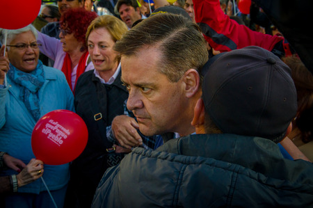 opposition: Quito, Ecuador - April 7, 2016: Closeup opposition leader Andres Paez sorrounded by people during anti government protests in Shyris Avenue.