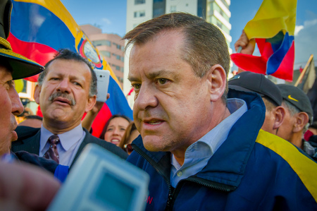 riots: Quito, Ecuador - April 7, 2016: Closeup opposition leader Andres Paez surrounded by people during anti government protests in Shyris Avenue.