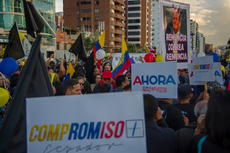 protest signs: Quito, Ecuador - April 7, 2016: Group of people Holding protest signs, police and journalists during anti government protests in Shyris Avenue. Editorial