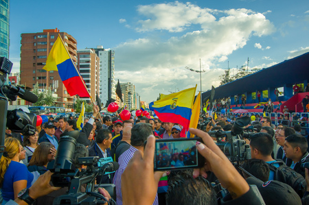 ecuadorian: Quito, Ecuador - April 7, 2016: Closeup opposition leader Andres Paez surrounded by people, police and journalists during anti government protests in Shyris Avenue.