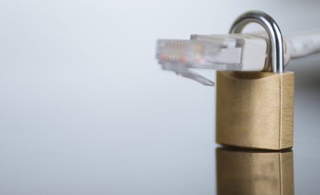 ethernet cable: Small padlock with ethernet cable going through it, internet security concept.