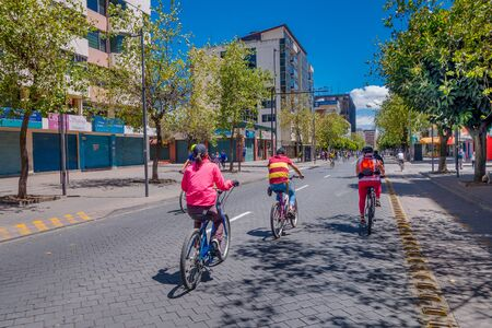 bycicle: QUITO, ECUADOR - MARZO 23, 2015: Sunny days were made to make sports, unidentified people take advantage of this and ride bycicle trought the city