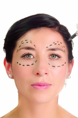 dotted lines: Headshot caucasian woman with dotted lines drawn around eyes looking into camera, preparing cosmetic surgery. Stock Photo