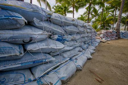 Esmeraldas, Ecuador - March 16, 2016: Sandbags to protect against the flood by tsunami in Same Beach, Casablanca.
