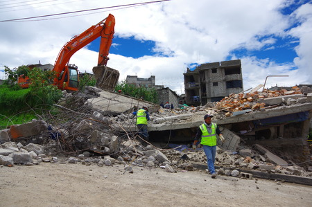 tremor: Quito, Ecuador - April,17, 2016: House destroyed by Earthquake with rescue team and heavy machinery in the south part of the city. Editorial