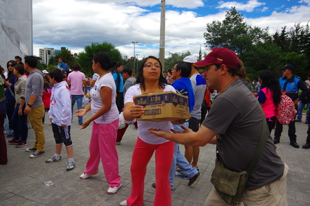 humanitarian aid: Quito, Ecuador - April,17, 2016: Unidentified citizens of Quito providing disaster relief food, clothes, medicine and water for earthquake survivors in the coast.
