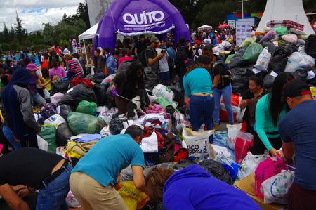 fema: Quito, Ecuador - April,17, 2016: Unidentified citizens of Quito providing disaster relief food, clothes, medicine and water for earthquake survivors in the coast.