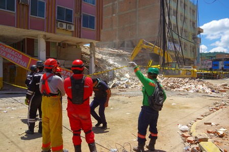 efforts: Portoviejo, Ecuador - April, 18, 2016: Rescue team making recovery efforts after 7.8 earthquake Editorial