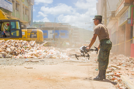 Portoviejo, Ecuador - April, 18, 2016: Drone operated by army to search for survivors after 7.8 earthquake in city center. Editorial