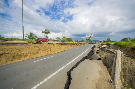 fissure: Portoviejo, Ecuador - April, 18, 2016: Cracked road after 7.8 earthquake.