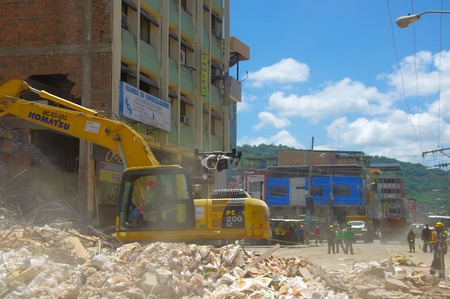 devastating: Portoviejo, Ecuador - April, 18, 2016: Heavy machinery picking rubble from destroyed buildings after tragic and devastating 7.8 earthquake in city center. Editorial