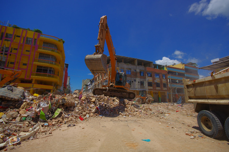 tragic: Portoviejo, Ecuador - April, 18, 2016: Heavy machinery picking rubble from destroyed buildings after tragic and devastating 7.8 earthquake in city center. Editorial