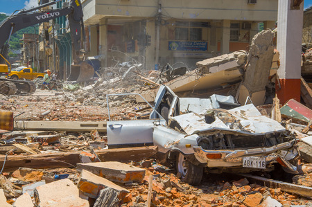 collapsed: Portoviejo, Ecuador - April, 18, 2016: Collapsed car, showing the aftereffect of 7.8 earthquake that destroyed the city center. Editorial