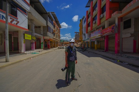 documenting: Portoviejo, Ecuador - April, 18, 2016: Unidentified photographer documenting the aftereffect of 7.8 earthquake that destroyed the city center.