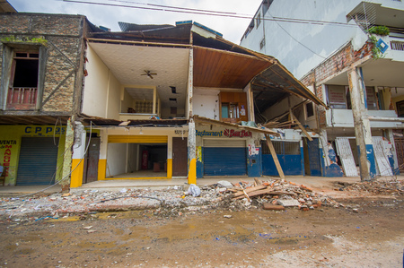 deployed: Portoviejo, Ecuador - April, 18, 2016: Two story house collapsed after 7.8 earthquake.