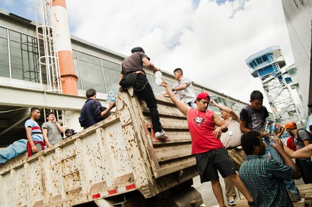 humanitarian aid: Quito, Ecuador - April 23, 2016: Volunteers of Quito providing disaster relief food, clothes, medicine and water for earthquake survivors in the coast. Gathered at Bicentenario Park.