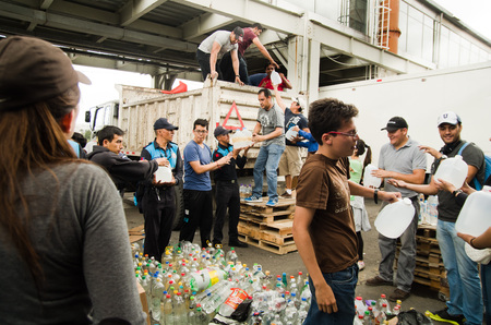 fema: Quito, Ecuador - April 23, 2016: Unidentified citizens of Quito providing disaster relief food, clothes, medicine and water for earthquake survivors in the coast. Gathered at Bicentenario Park.