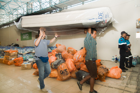 food distribution: Quito, Ecuador - April 23, 2016: Bags of supplies for disaster relief with food, clothes, medicine and water for earthquake survivors in the coast. Gathered at Bicentenario Park for distribution in Manabi province Editorial