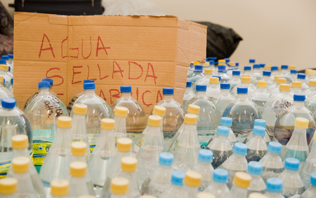 Quito, Ecuador - April 23, 2016: Water donated by citizens of Quito providing disaster relief for earthquake survivors in the coast. Gathered at Bicentenario Park.