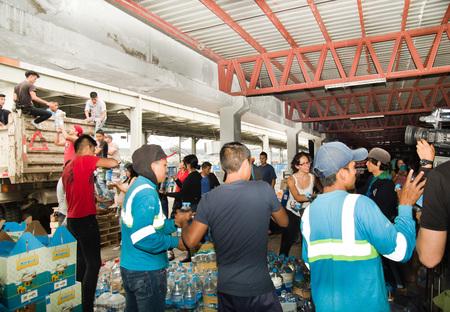 fema: Quito, Ecuador - April 23, 2016: Volunteers of Quito providing disaster relief food, clothes, medicine and water for earthquake survivors in the coast. Gathered at Bicentenario Park.
