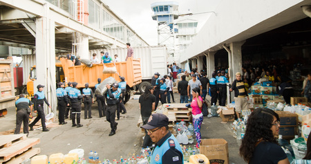 fema: Quito, Ecuador - April 23, 2016: Bags of supplies for disaster relief with food, clothes, medicine and water for earthquake survivors in the coast. Gathered at Bicentenario Park for distribution in Manabi province Editorial