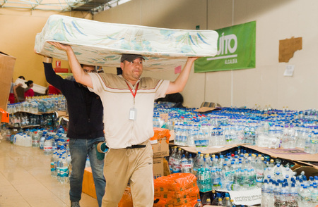 Quito, Ecuador - April 23, 2016: Bags of supplies for disaster relief with food, clothes, medicine and water for earthquake survivors in the coast. Gathered at Bicentenario Park for distribution in Manabi province Editorial