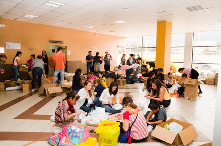 humanitarian aid: Quito, Ecuador - April 23, 2016: Unidentified Volunteers of Quito providing disaster relief for earthquake survivors in the coast. Gathered at Bicentenario Park. Editorial