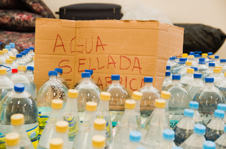 fema: Quito, Ecuador - April 23, 2016: Water donated by citizens of Quito providing disaster relief for earthquake survivors in the coast. Gathered at Bicentenario Park.