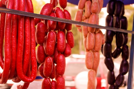 longaniza: Red, black and longaniza sausages hanging in a Quitos market, ready to be cooked Stock Photo