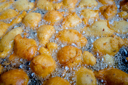 batters: Fried batters in a big pan, the way to make fritters in Ecuador. Traditional dessert Stock Photo