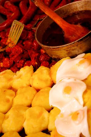 potatoe: Delicious dish with various options, mashed potatoe, sausage and egg fried on oil ready to serve Stock Photo