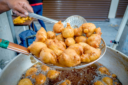 sift: After fried the doughts need to be sift, traditional ecuadorian food. Dessert