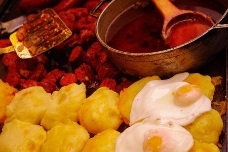 potatoe: Fried red chorizo with potatoe tortillas and fried eggs, traditional and delicious ecuadorian dish