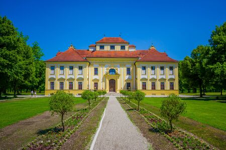 other side of: Schleissheim, Germany - July 30, 2015: Lustheim palace building, located on the other side of Schleissheim gardens, beautiful sunny day and green sorroundings.