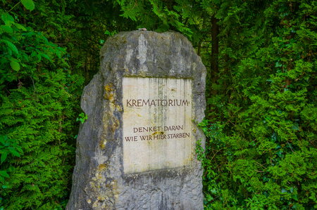 sachsenhausen: Dachau, Germany - July 30, 2015: A stone sign with the word Krematorium written on it, shameful reminder of what happened at concentration camp.