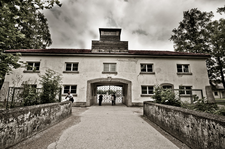 german fascist: Dachau, Germany - July 30, 2015: Entrance to famous concentration camp from world war 2.